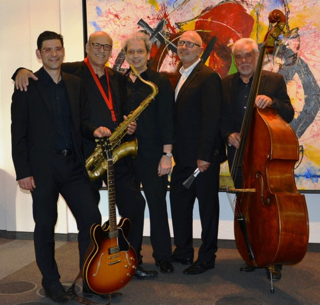A group of people standing in front of a instrument