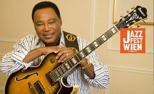 George Benson holding a guitar